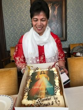 Malou Pimentel of the Divine Mercy apostolate with a special mercy-cake